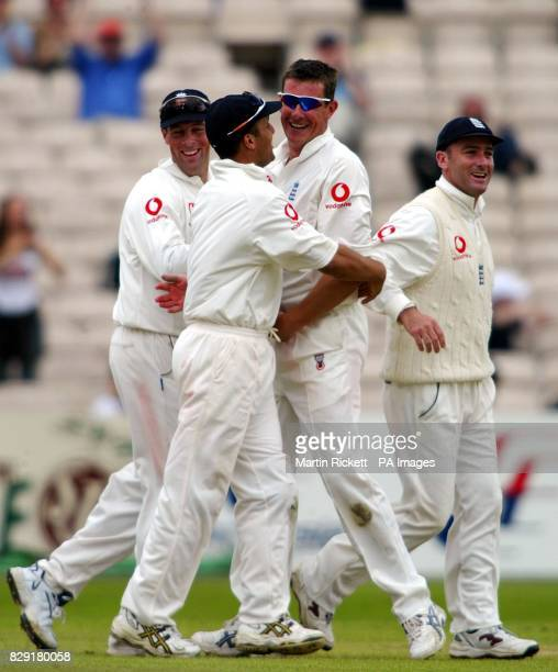England's Ashley Giles celebrates taking the wicket of Sri Lanka's Hashan Tillakaratne during the Third Test at Old Trafford Manchester
