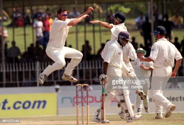 England's Ashley Giles celebrates trapping Sri Lanka's Mahela Jayawardene to leave them struggling on 596