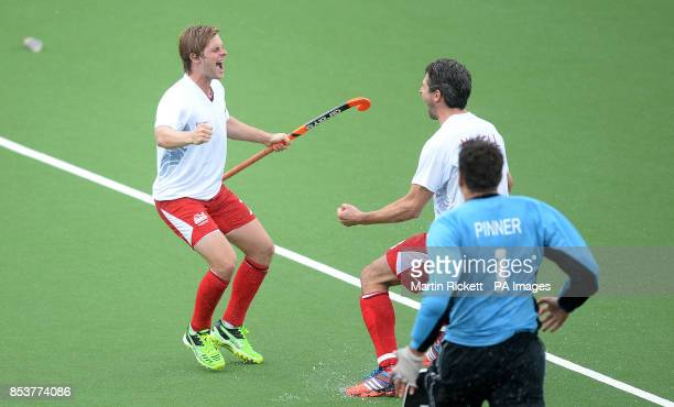 England's Ashley Jackson celebrates scoring the winning penalty flick in the bronze medal game against New Zealand with Simon Mantell and goalkeeper...