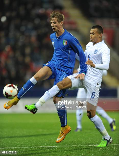 England's Bamidele Alli and Italy's Vido Luca battle for the ball
