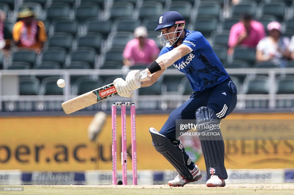 England's batsman Alex Hales plays a shot during the fourth One Day International match between England and South Africa at Wanderers on February 12, 2016 in Johannesburg. South African player are dressed in pink to raise awareness for breast cancer. / AFP / GIANLUIGI GUERCIA