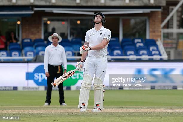 England's batsman Ben Stokes looks at the ball before getting caught out by Morne Morkel during day two of the third Test match between South Africa...