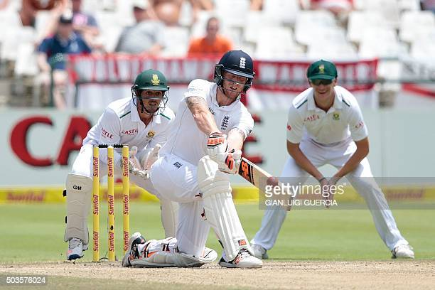 England's batsman Benjamin Stokes plays a shot before getting caught out during day 5 of the second Test match between England and South Africa at...