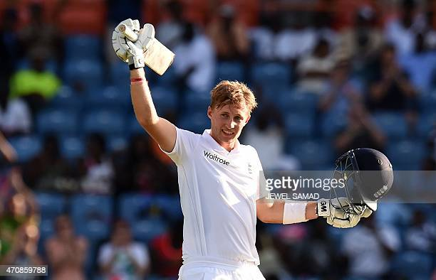 England's batsman Joe Root celebrates scoring his century during day three of the second Test cricket match between the West Indies and England at...