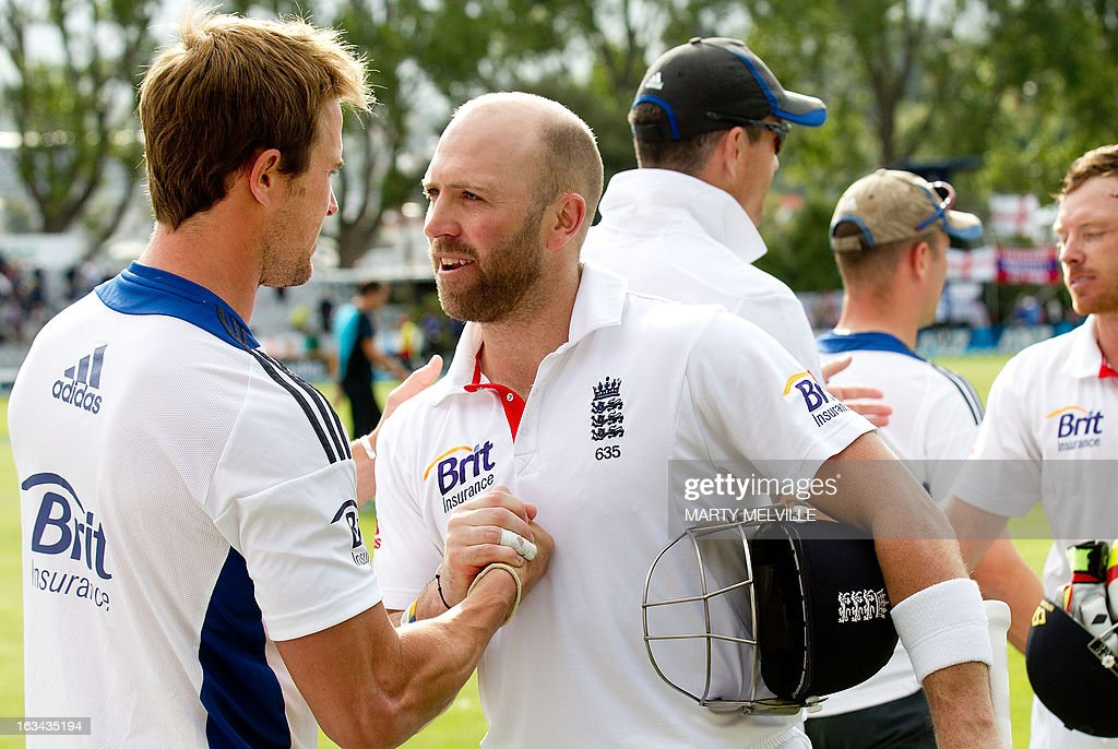 England's batsman Matt Prior (R) shakes hands with team mate Nick Compton at the end of play during day four of the first international cricket Test match between New Zealand and England played at the University Oval park in Dunedin on March 10, 2013. AFP PHOTO / Marty MELVILLE