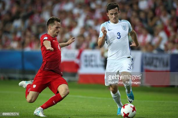 England's Ben Chilwell and Poland's Tomasz Kedziora battle for the ball during the UEFA European Under21 Championship Group A match at the Kolporter...