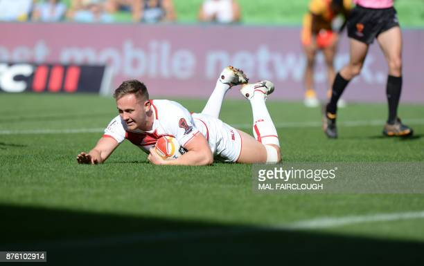 Englands Ben Currie scores a try during their Rugby League World Cup quarterfinal match between England and Papua New Guinea in Melbourne on November...