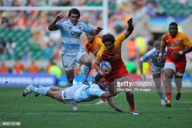 England's Ben Gollings aviods a tackle from Argentina's Lucas Alcacer during match 24 of the IRB Emirates Airline London Sevens at Twickenham Stadium...