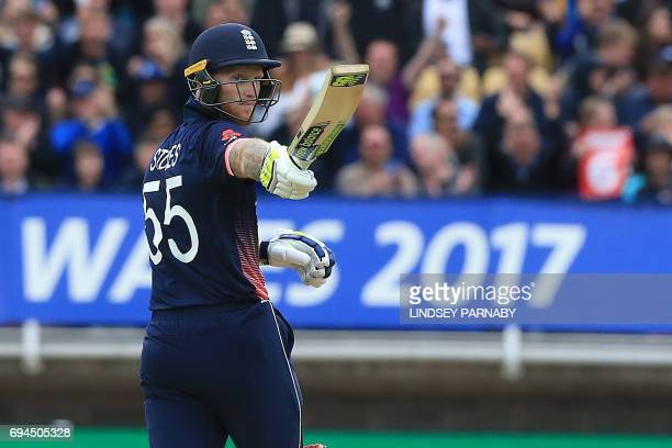 England's Ben Stokes celebrates reaching 50 during the ICC Champions Trophy match between England and Australia at Edgbaston in Birmingham central...