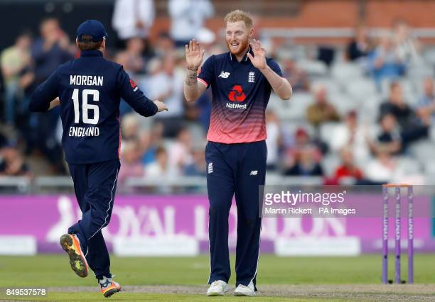 England's Ben Stokes celebrates taking the wicket of West Indies' Shai Hope with Eoin Morgan during the first Royal London One Day International...