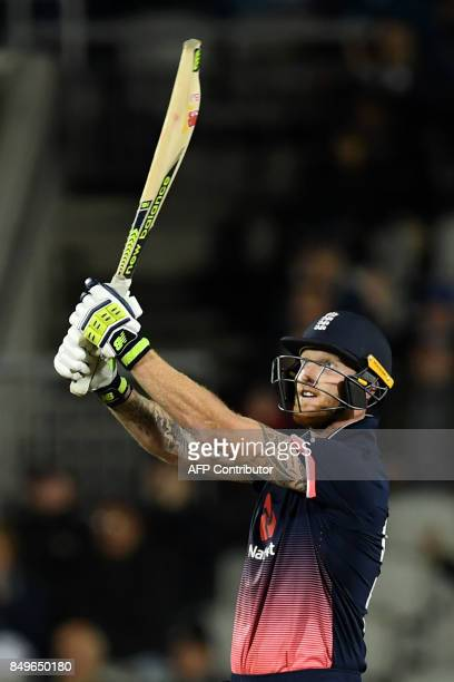 England's Ben Stokes celebrates victory during the first OneDay International cricket match between England and the West Indies at Old Trafford...