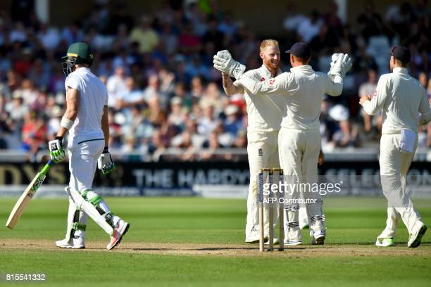 England's Ben Stokes celebrates with England's Jonny Bairstow after taking the wicket of South Africa's Faf du Plessis during play on the third day...
