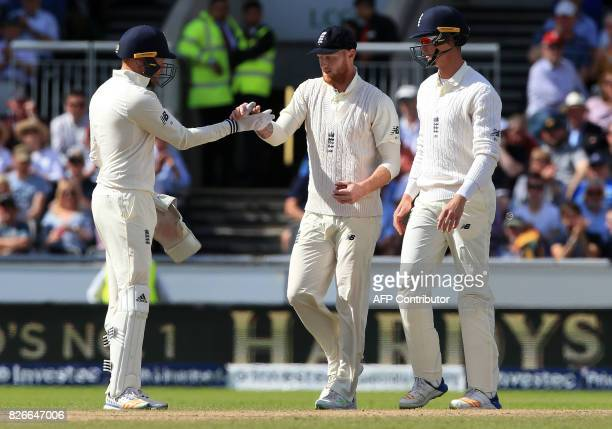 England's Ben Stokes celebrates with teammates the wicket of South Africa's Heino Kuhn on the second day of the fourth Test match between England and...