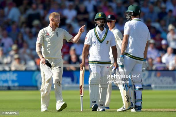 England's Ben Stokes gestures towards South Africa's Vernon Philander and Chris Morris on the third day of the second Test match between England and...