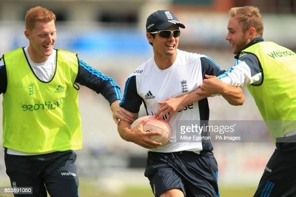 England's Ben Stokes with captain Alastair Cook and Stuart Broad