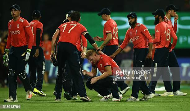 England's Ben Stokesis consoled by teammates after losing the World T20 cricket tournament final match between England and West Indies at The Eden...