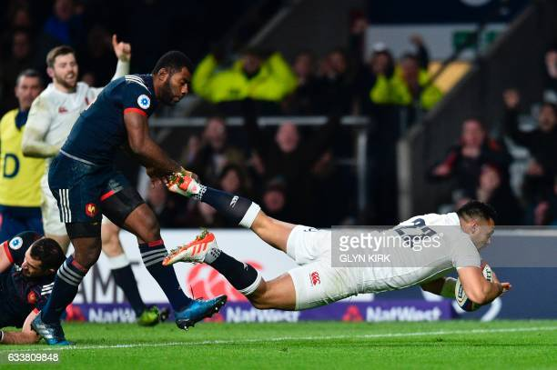 England's Ben Te'o dives over to score a try during the Six Nations international rugby union match between England and France at Twickenham stadium...