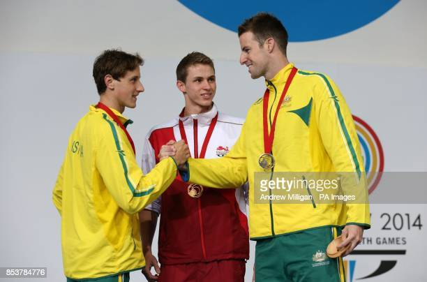 England's Benjamin Proud collects his gold medal for the Men's 50m Freestyle Final alongside silver medalist Cameron Mcevoy and bronze medalist James...