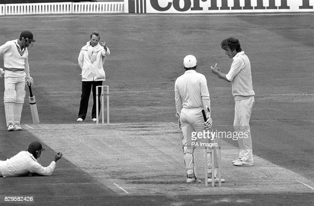 England's Bob Willis gets his fourth wicket as teammate Allan Lamb dives to catch the ball and umpire David Constant gives New Zealand's Martin Crowe...
