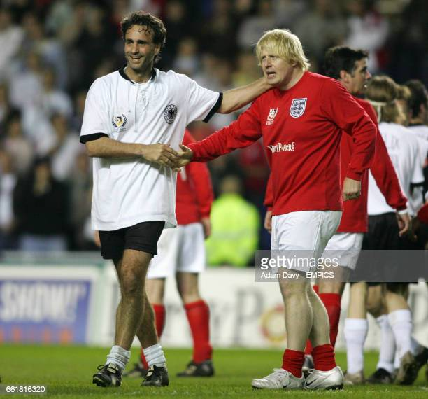 England's Boris Johnson and Germany's Maurizio Gaudino shake hands at the end of the game