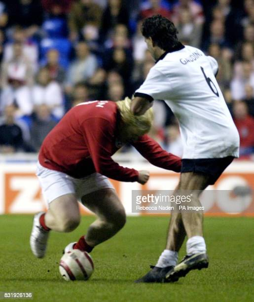 England's Boris Johnson tackles Germany's Maurizio Gaudino during the Legends match at the Madejski Stadium in Reading