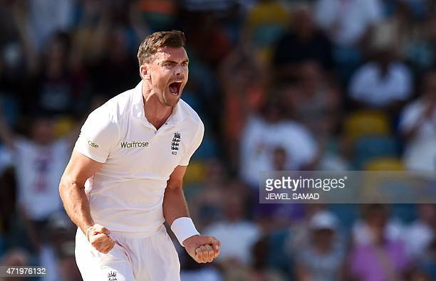 England's bowler James Anderson celebrates dismissing West Indies batsman Veerasammy Permaul during day two of the final match of a threematch Test...