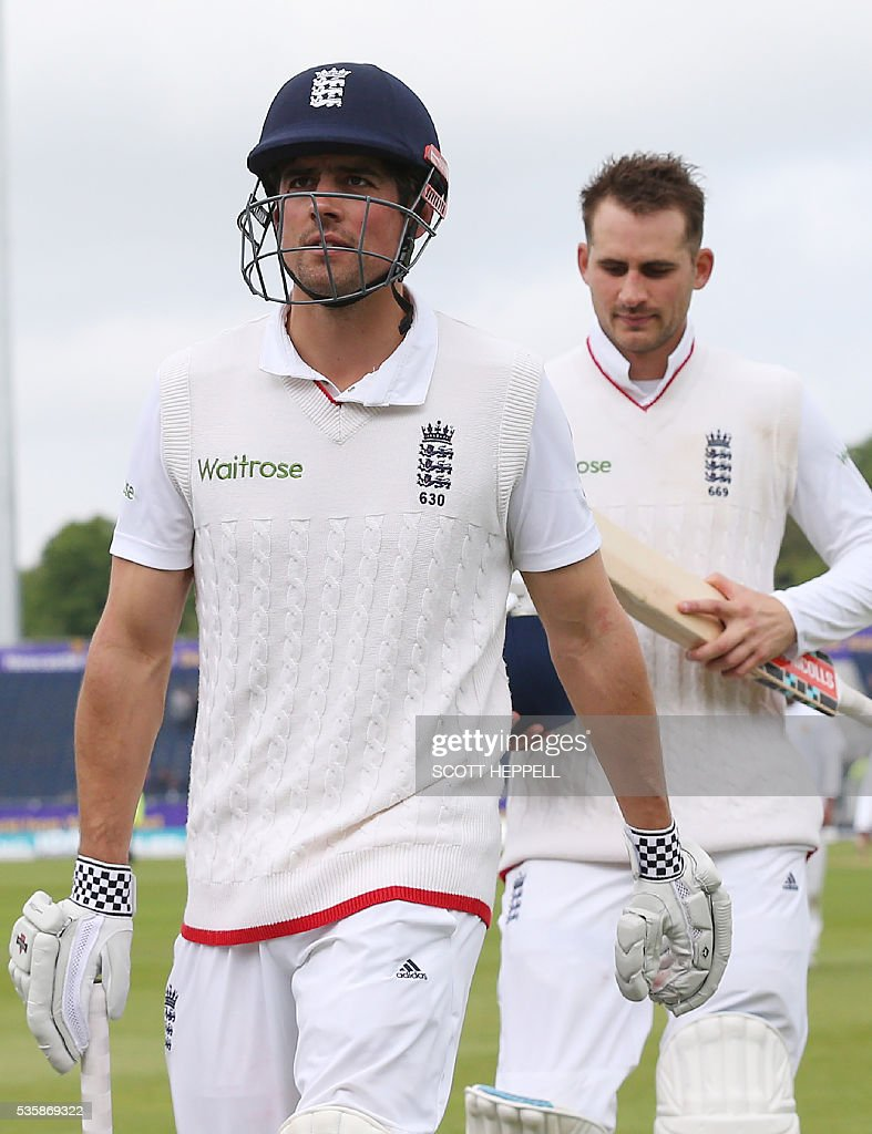 England's captain Alastair Cook (L) and Alex Hales leave the field for a tea break as they play on the fourth day of the second test cricket match between England and Sri Lanka at the Riverside in Chester-le-Street, north east England, on May 30, 2016. / AFP / SCOTT