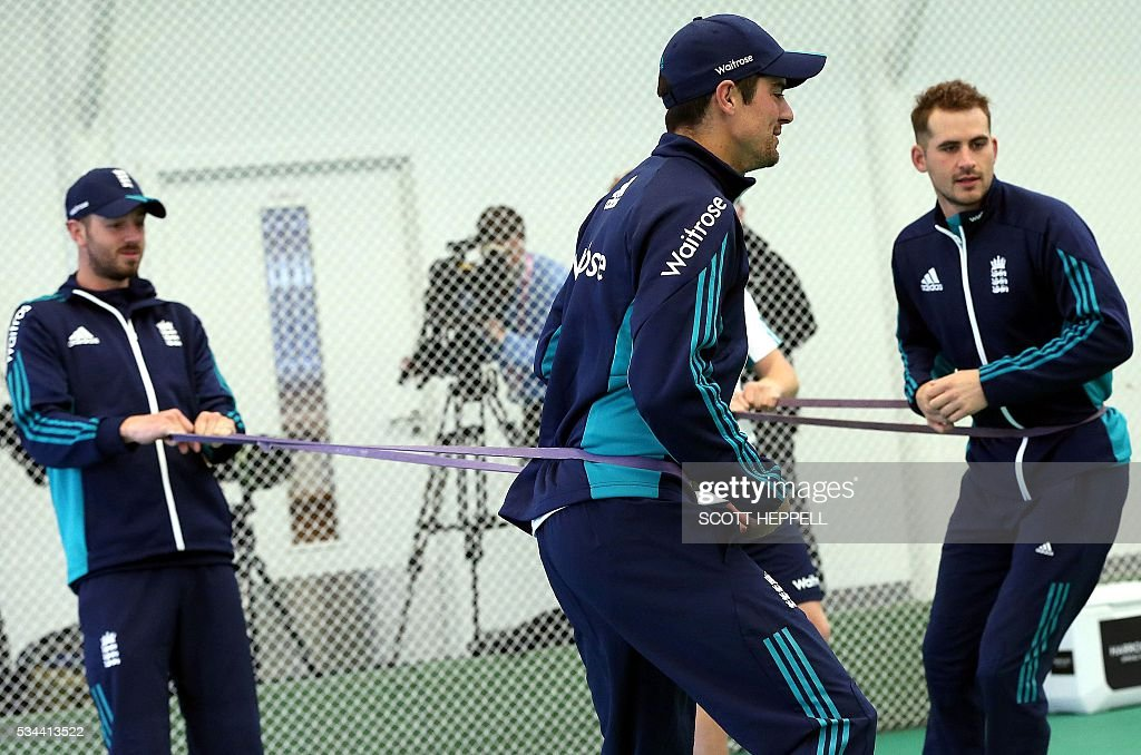 England's captain Alastair Cook (L) and England's Alex Hales (R) use bands as they take part in an indoor practise session ahead of the second cricket Test match between England and Sri Lanka in Chester-le-Street, north east England on May 26, 2016. England may come into the second Test against Sri Lanka in Durham on the back of a crushing win in the series opener, but according to Stuart Broad the hosts have still to hit top form. England are set to play Sri Lanka in a second test cricket match on May 27. / AFP / SCOTT