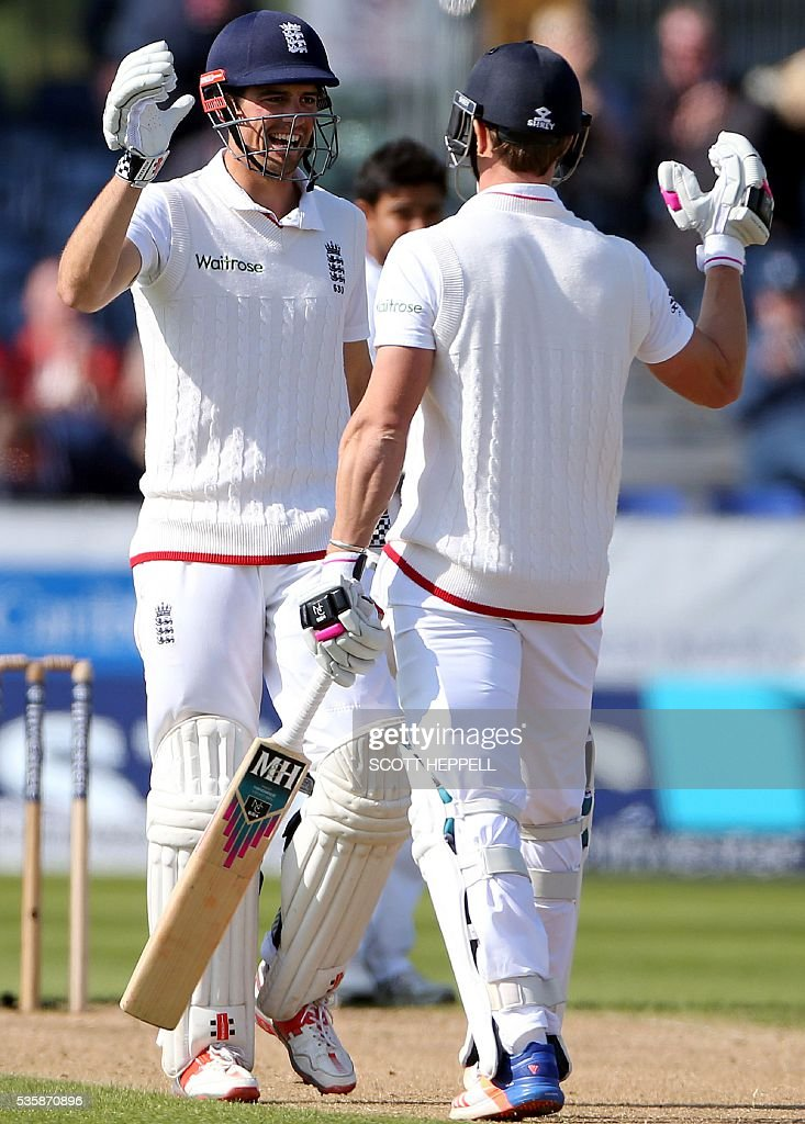 England's captain Alastair Cook (L) and England's Nick Compton celebrate after winning the 2nd Test match on the fourth day of the second test cricket match between England and Sri Lanka at the Riverside in Chester-le-Street, north east England, on May 30, 2016. / AFP / SCOTT