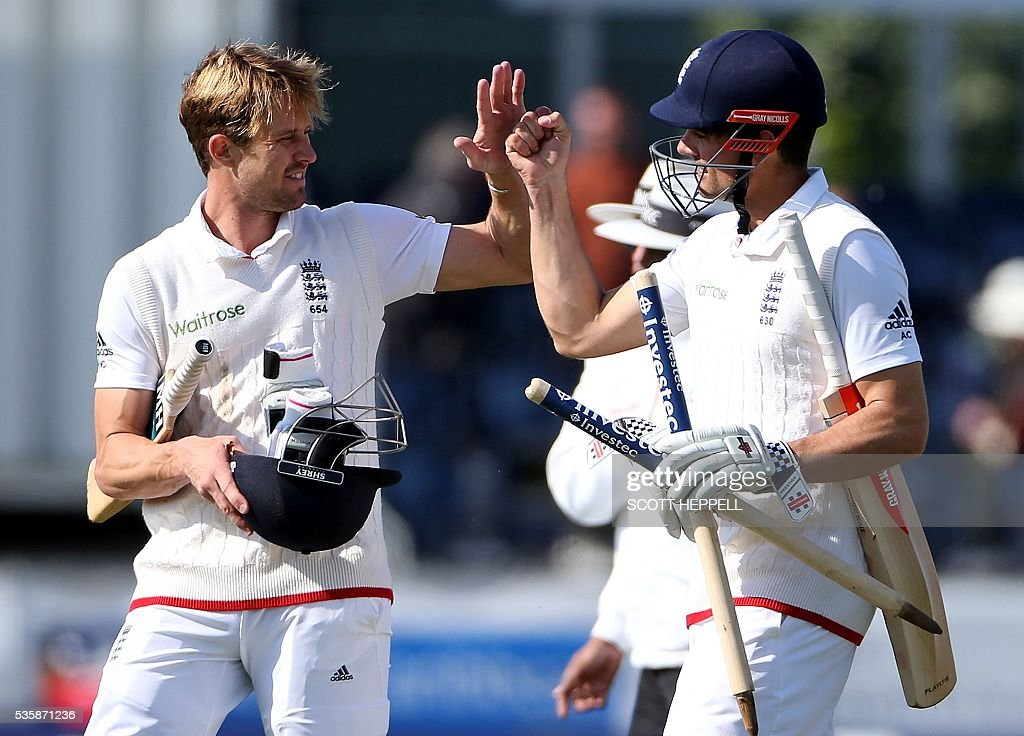 England's captain Alastair Cook (R) and England's Nick Compton celebrate after England won the 2nd Test match on the fourth day of the second test cricket match between England and Sri Lanka at the Riverside in Chester-le-Street, north east England, on May 30, 2016. / AFP / SCOTT