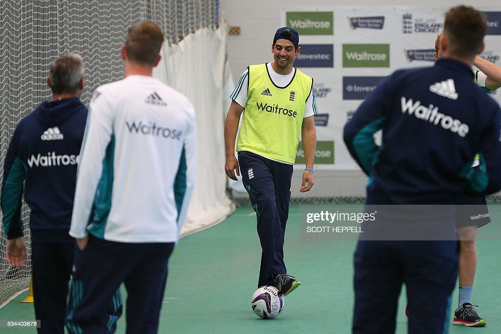 England's captain Alastair Cook (C) kicks a football as he warms up with teammates during an indoor practise session ahead of the second cricket Test match between England and Sri Lanka in Chester-le-Street, north east England on May 26, 2016. England may come into the second Test against Sri Lanka in Durham on the back of a crushing win in the series opener, but according to Stuart Broad the hosts have still to hit top form. England are set to play Sri Lanka in a second test cricket match on May 27. / AFP / SCOTT