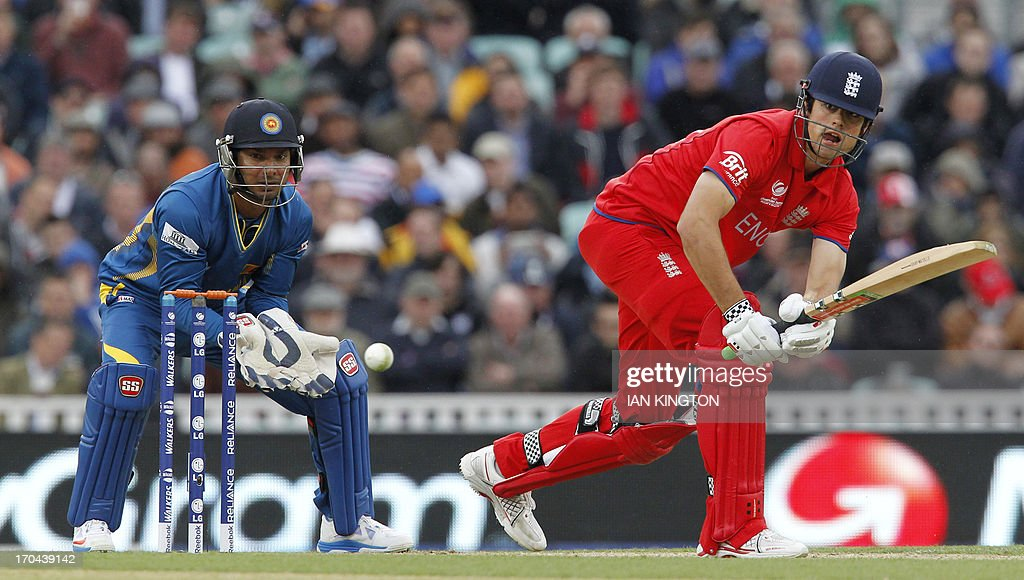 England's Captain Alastair Cook (R) plays a shot as Sri Lanka's Wicketkeeper Kumar Sangakkara looks on during the 2013 ICC Champions Trophy One Day International (ODI) cricket match between England and Sri Lanka at The Oval cricket ground in London on June 13, 2013. Sri Lanka won the toss and elected to field first.