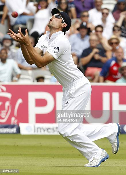 Englands Captain Alastair Cook takes the catch to dismiss Indias Stuart Binny for no runs during the fourth day of the second Test cricket match...