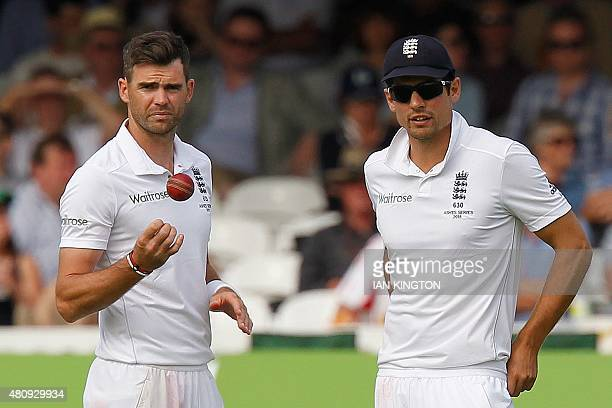 Englands Captain Alastair Cook talks to Englands James Anderson in the field during play on the first day of the second Ashes cricket test match...