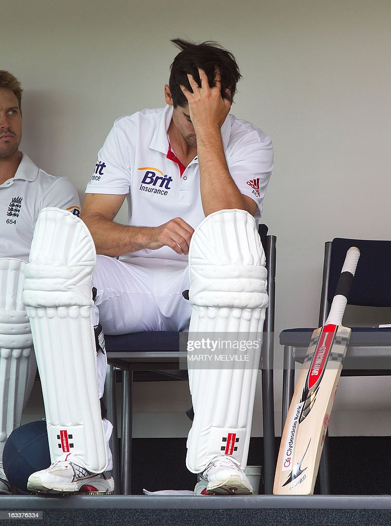 England's captain Alastair Cook waits in the team room for the start of play after lunch during day four of the first international cricket Test match between New Zealand and England played at the University Oval park in Dunedin on March 9, 2013. AFP PHOTO / Marty MELVILLE