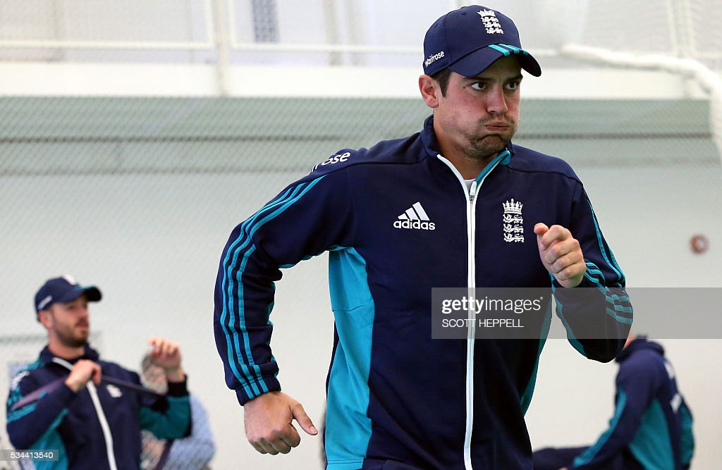 England's captain Alastair Cook wamrs up during an indoor practise session ahead of the second cricket Test match between England and Sri Lanka in Chester-le-Street, north east England on May 26, 2016. England may come into the second Test against Sri Lanka in Durham on the back of a crushing win in the series opener, but according to Stuart Broad the hosts have still to hit top form. England are set to play Sri Lanka in a second test cricket match on May 27. / AFP / SCOTT