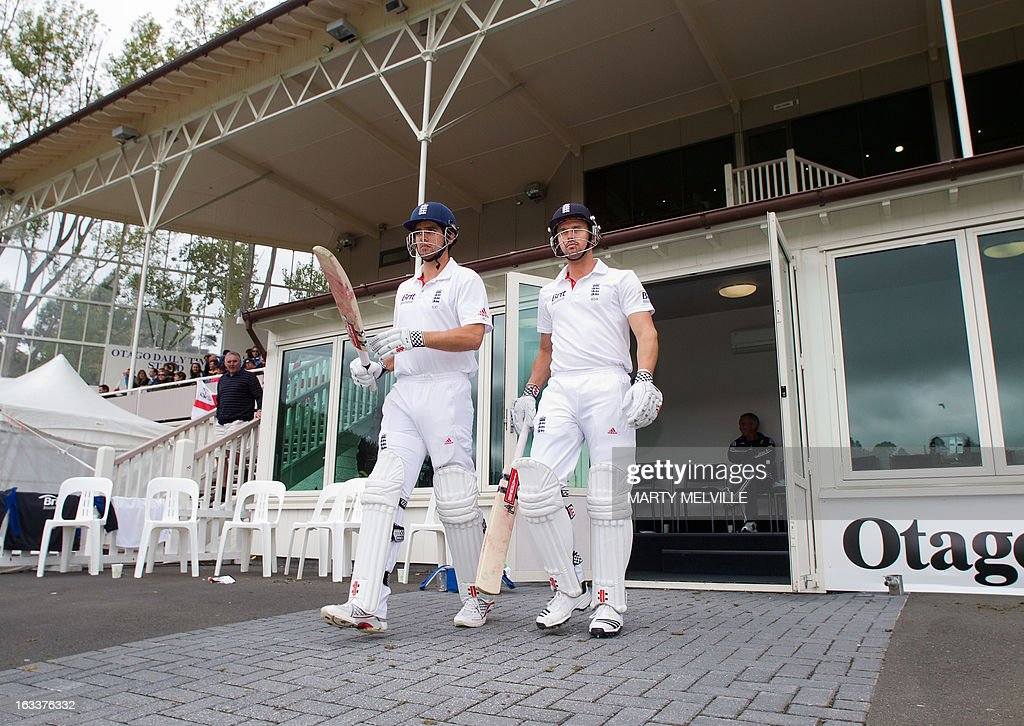 England's captain Alastair Cook (L) with teammate Nick Compton walk out to the field at start of play after lunch during day four of the first international cricket Test match between New Zealand and England played at the University Oval park in Dunedin on March 9, 2013. AFP PHOTO / Marty MELVILLE