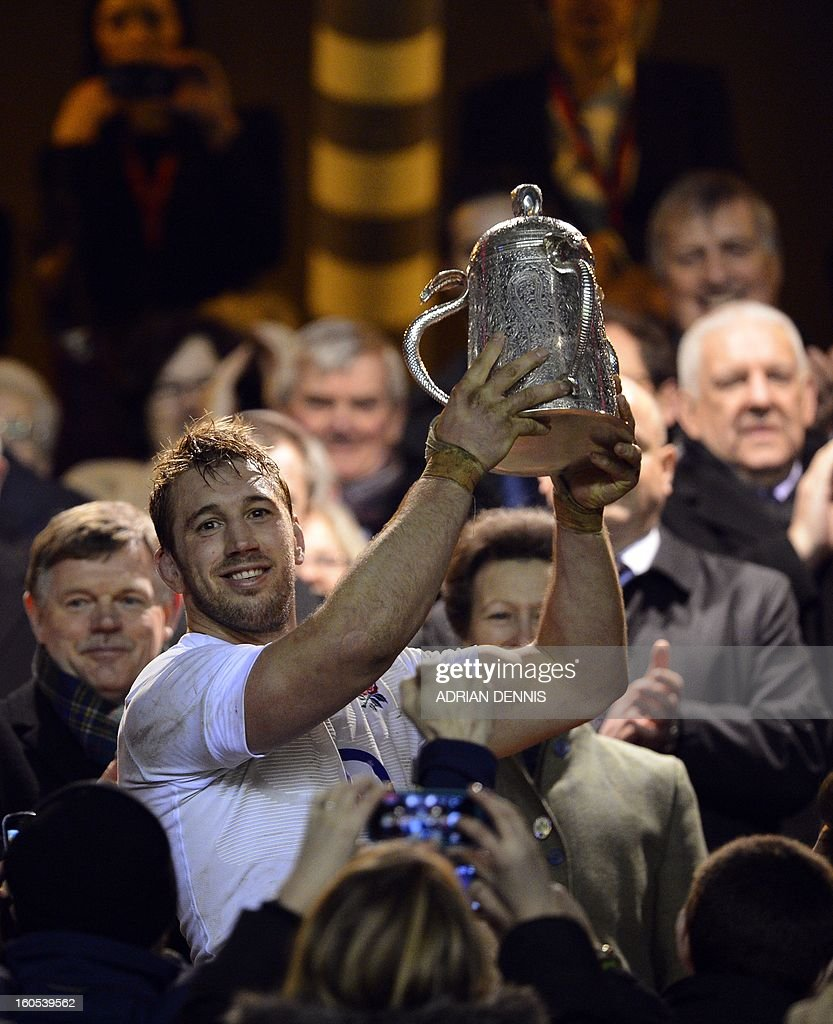 England's Captain Chris Robshaw lifts the Calcutta Cup after beating Scotland during the 6 Nations international rugby union match between England and Scotland at Twickenham Stadium, southwest of London on February 2, 2013. England won the game 38-18.