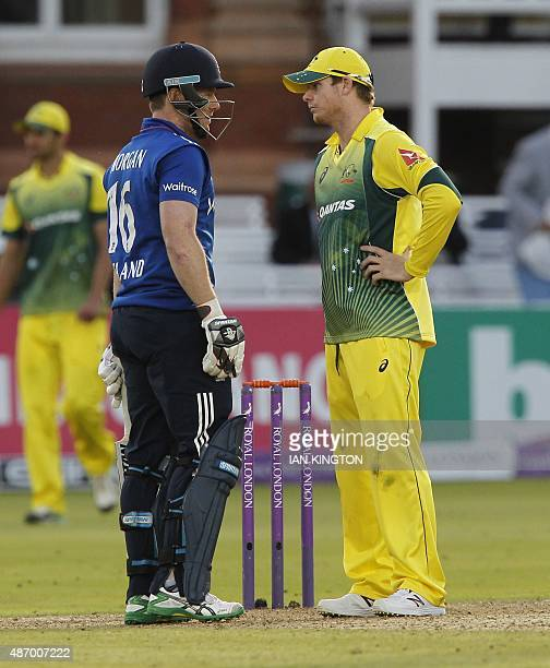 Englands captain Eoin Morgan and Australias captain Steven Smith carry on with discussions after the final wicket is lost and Australia win the game...