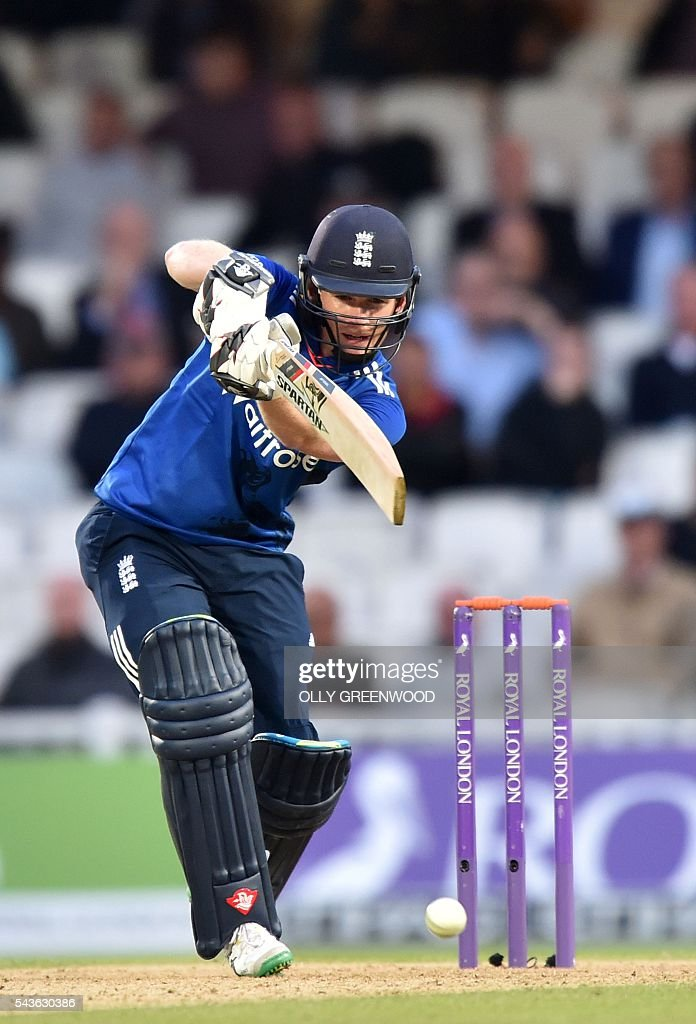 England's captain Eoin Morgan plays a shot during play in the fourth One Day International (ODI) cricket match between England and Sri Lanka at The Oval cricket ground in London on June 29, 2016. England's victory target was revised to 308 off 42 overs due to the weather having seen the tourists show real guile and style in their innings. / AFP / OLLY