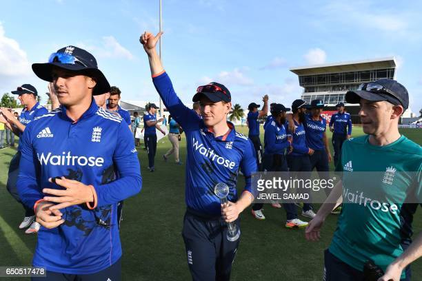 England's captain Eoin Morgan waves at supporters holding their winning trophy at the end of the final of threematch One Day International series...