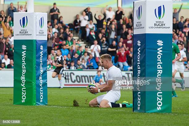 England's captain Harry Mallinder slides over the line on his knees to score his second try between the posts during the World Rugby U20 Championship...