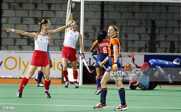 England's captain Kate Walsh celebrates after scoring the winning goal against the Netherlands during their Womens' Champions Trophy match played in...