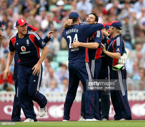 England's Captain Kevin Pietersen hugs Steve Harmison after taking the wicket of South Africa's Hashim Amla