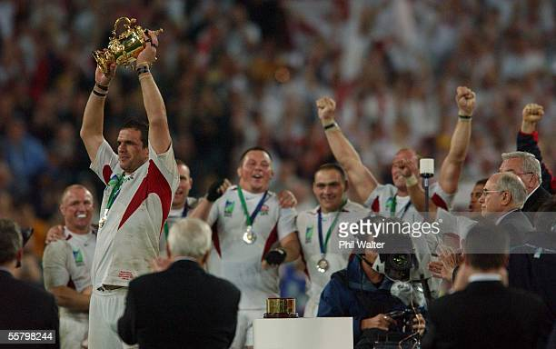 England's captain Martin Johnson holds up the William Webb Ellis Trophy as his team mates celebrate following the 2003 Rugby World Cup Final played...