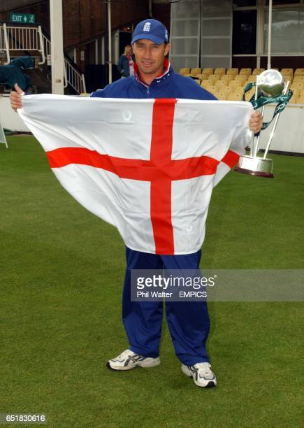 England's captain Nasser Hussain holds the flag with the npower trophy before the 2nd cricket test against Sri Lanka at Edgbaston