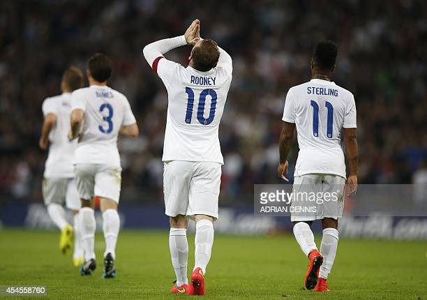 England's captain Wayne Rooney celebrates scoring the opening goal of the international friendly football match between England and Norway at Wembley...