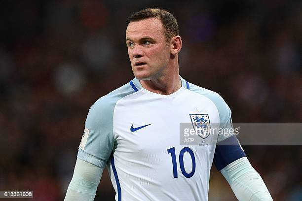 England's captain Wayne Rooney is pictured during the World Cup 2018 football qualification match between England and Malta at Wembley Stadium in...