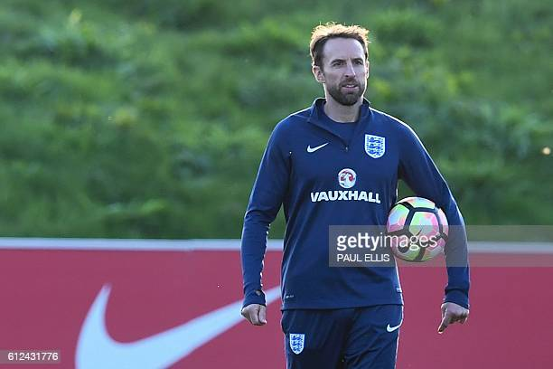 England's caretaker manager Gareth Southgate leads a training session at England's training facility at St George's Park in BurtonuponTrent in...