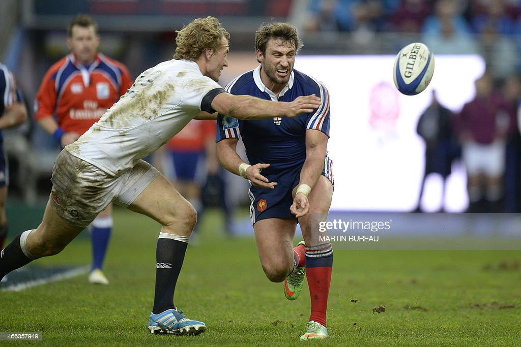 England's centre Billy Twelvetrees (L) goes to tackle France's winger Maxime Medard (R) during the Six Nations rugby union match between France and England on February 1, 2014 at the Stade de France in Saint-Denis, north of Paris.